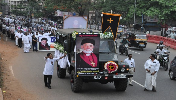 Decorated vehicle carrying the photograph of  Patriarch  Maran Mar Dinkha in the procession.